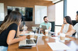 Coworkers Planning In Discussion At Office