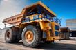 Leinwandbild Motiv heavy yellow quarry dump truck at repair station at sunny cloudless day