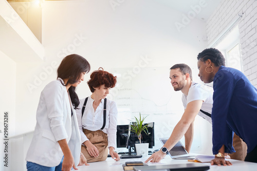 Fototapety, obrazy: diverse company staff workers group chatting, discussing in white office