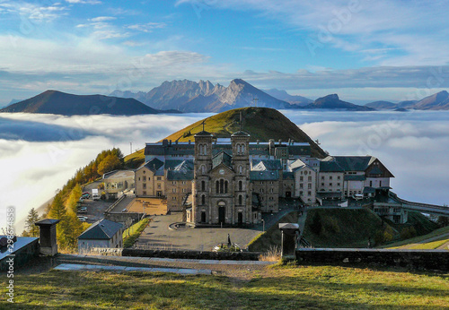 Shrine of Our Lady La Salette above the clouds Wallpaper Mural
