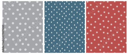Cute Scandinavian Style Winter Vector Pattern with White Trees and Snowflakes Isolated on a Gray, Blue and Pale Red Background. Simple Winter Forest Vector Print and Snowy Sky Design.