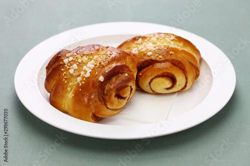 Fotografie, Obraz Homemade finnish cinnamon roll, freshly made