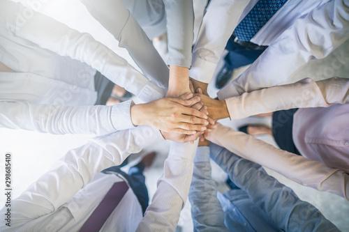 Fotografía Stack of hands. Unity and teamwork concept.