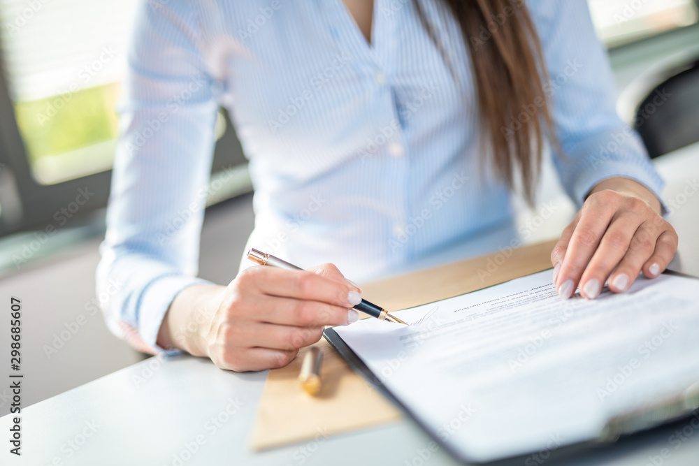 Fototapeta Business woman signing contract, making a deal.