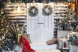 Leinwanddruck Bild - Winter rustic interior decorated for New year with artificial snow and Christmas tree. Winter exterior of a country house with Christmas decorations in rustic style. Christmas eve