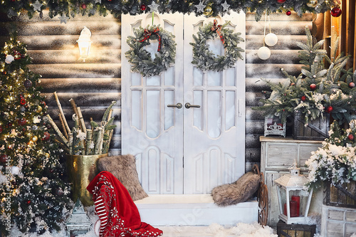 Foto  Winter rustic interior decorated for New year with artificial snow and Christmas tree