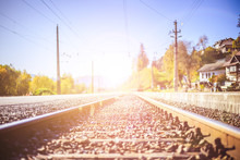 Sustainable Traveling By Train: Rail Track And Colorful, Idyllic Landscape In Fall.
