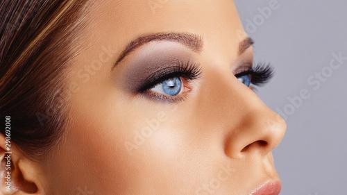 Fototapeta Woman eyes with long eyelashes and smokey eyes make-up