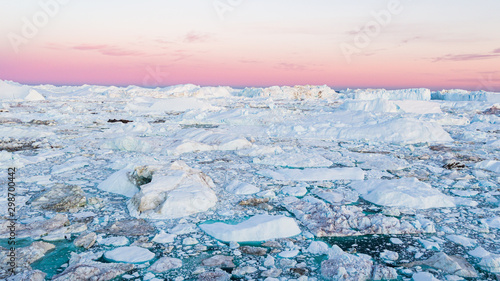 Fototapeta  Global warming - Greenland Iceberg landscape of Ilulissat icefjord with giant icebergs