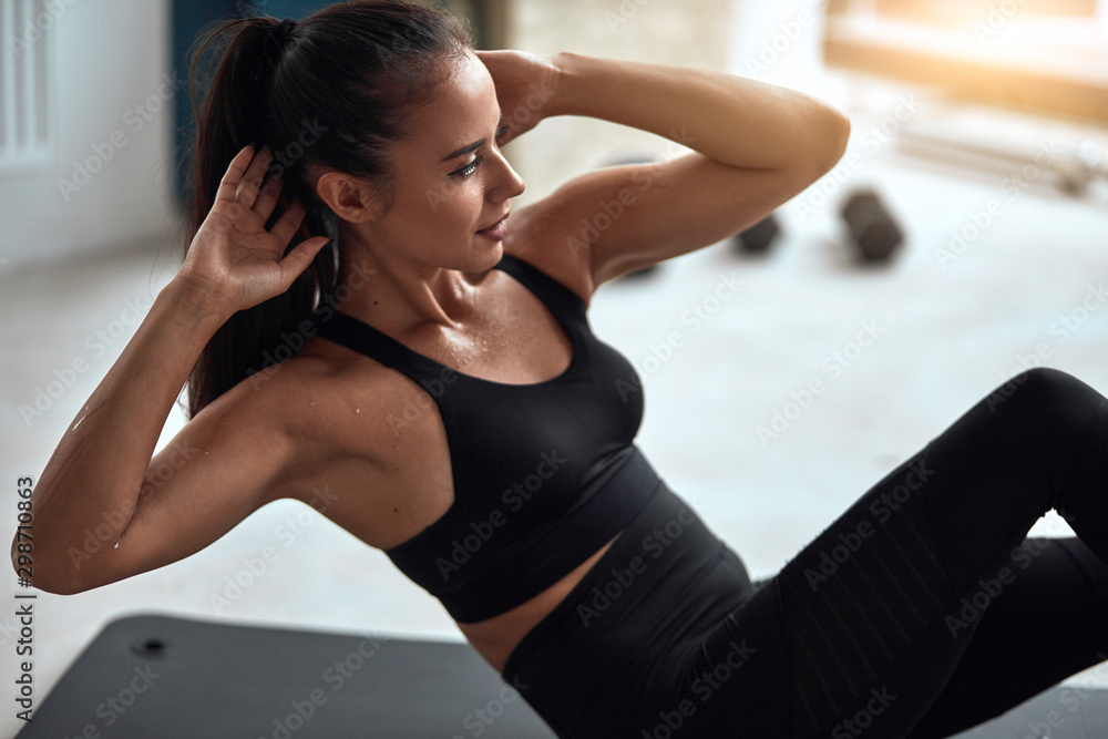 Fototapety, obrazy: Attractive fit female pump press in gym. Fitness girl in black sportswear exercising