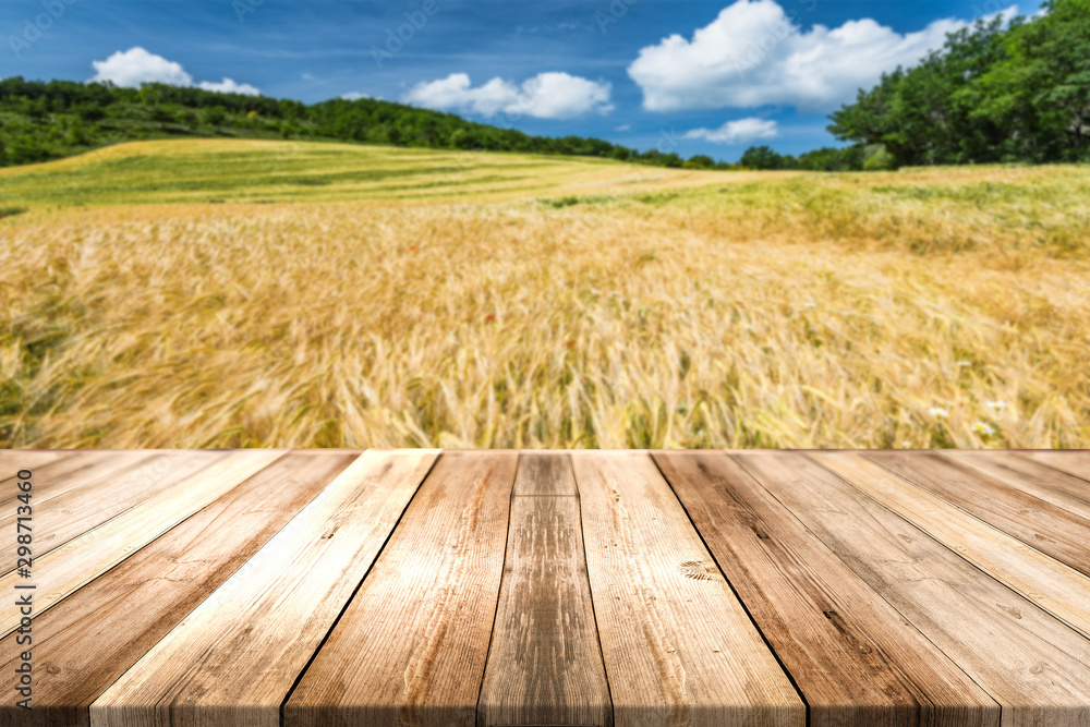 Fototapeta Wooden Board Product Display Montage or Background. Organic Food Produce Theme