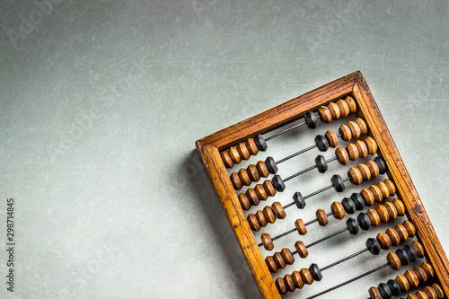 Obraz na plátně Old wooden scratched vintage decimal abacus on concrete background