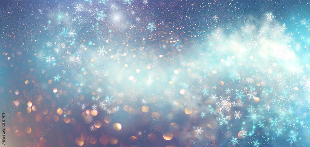 Fototapeta Winter Christmas and New Year glittering snow flakes swirl bokeh background, backdrop with sparkling blue stars, holiday garland, magic glowing stars, lights. Abstract Glitter Blinking sparks