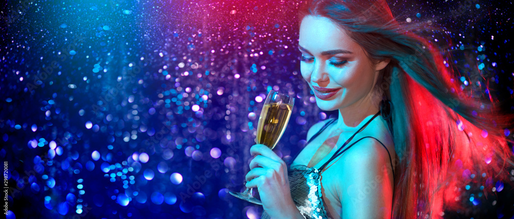 Fototapety, obrazy: Model girl with glass of champagne drinking and dancing at disco party, on holiday glowing blue with red background. Beauty woman, perfect fashion makeup. Christmas and New Year holiday celebration