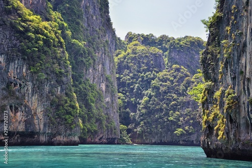 Foto auf Leinwand Blaue Nacht Island, Ocean views near Phuket Thailand with Blues, Turquoise and Greens oceans, mountains, boats, caves, trees resort island of phuket Thailand. Including Phi Phi, Ko Rang Yai, Ko Li Pe and other is