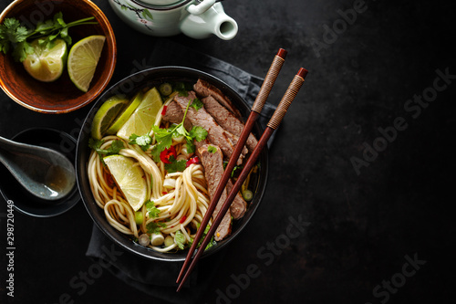 Cuadros en Lienzo  Tasty asian classic soup with noodles and meat