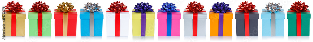 Fototapeta Group of christmas presents birthday gifts in a row isolated on white