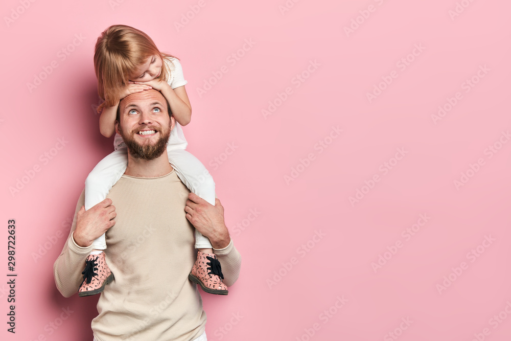 Fototapety, obrazy: happy handsome daddy looking at his little adorable girl who is sleeping on his shoilders, redt time, free time, spare time. close up portrait, isolated pink background, studio shot