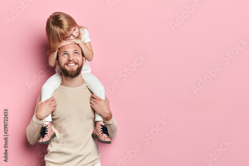 Fotografiet  happy handsome daddy looking at his little adorable girl who is sleeping on his shoilders, redt time, free time, spare time