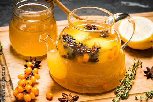 Pinturas sobre lienzo  Sea buckthorn hot drink with orange juice and spices in glass teapot