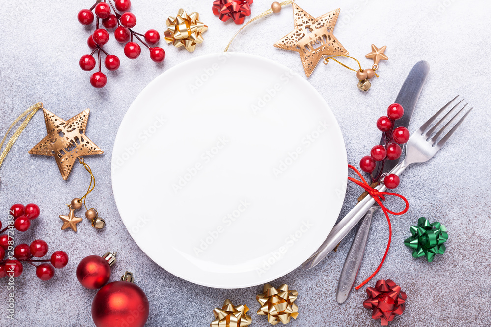 Fototapety, obrazy: Christmas table place setting with empty white plate, cutlery with festive decorations star bow ball on stone background. Christmas and New Year holiday concept - Image