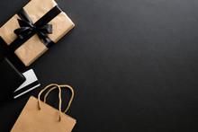 Black Friday Sale Concept. Frame Made Of Gift Box, Credit Card, Shopping Bag Over Black Background