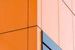 Leinwanddruck Bild - Geometric color elements of the building facade with planes, lines, corners with highlights and reflections for an abstract background and texture of gray, orange, blue colors. Place for text