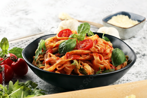 tagliatelle pasta with tomato sauce parmesan basil on rustic background Fototapete