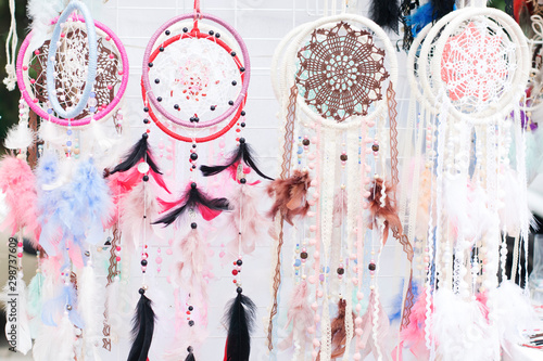 Foto auf Gartenposter Boho-Stil Dream catchers in a shop window, boho ethnic style.