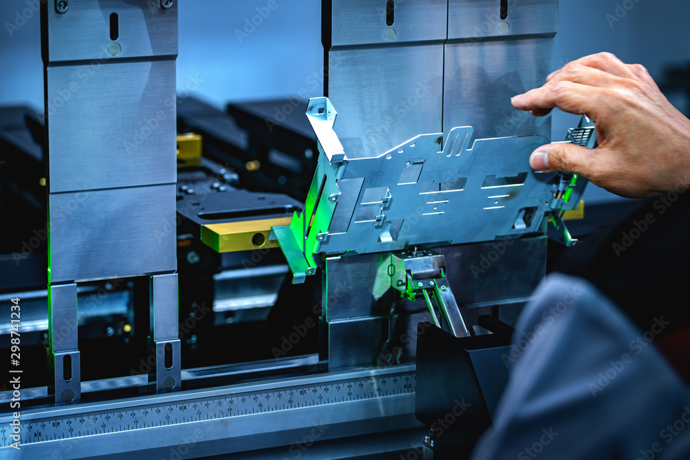 Fototapety, obrazy: Workers bending sheet metal by CNC machines in industrial plants