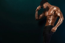 Strong And Fit Man Bodybuilder. Sporty Muscular Guy Athlete. Sport And Fitness Concept. Men's Fashion.