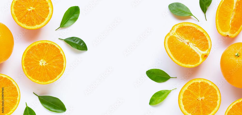 Fototapety, obrazy: Fresh orange citrus fruit with leaves isolated on white background.