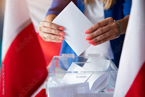 Obraz na plátně Woman putting her vote to ballot box. Poland political elections