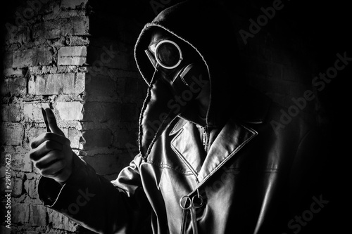 Terrible plague doctor with scalpel, black and white Wallpaper Mural