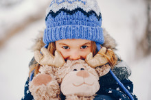 Kid In A Winter Forest. Girl I...