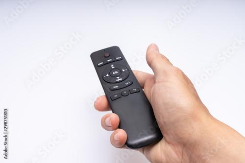 Obraz  Hand holding a remote control - fototapety do salonu