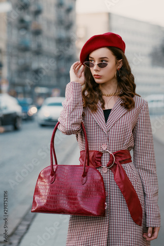 Outdoor fashion portrait of young elegant luxury lady wearing houndstooth print Wallpaper Mural