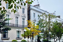 Elegant Private Houses In London, England. Notting Hill Is Famous For Its White And Coloured Buildings And Casual Cafes