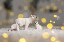 Decorative Figurines Of A Christmas Theme. Statuettes Of A Family Of Polar Bears. Christmas Tree Decoration. Festive Decor, Warm Bokeh Lights.
