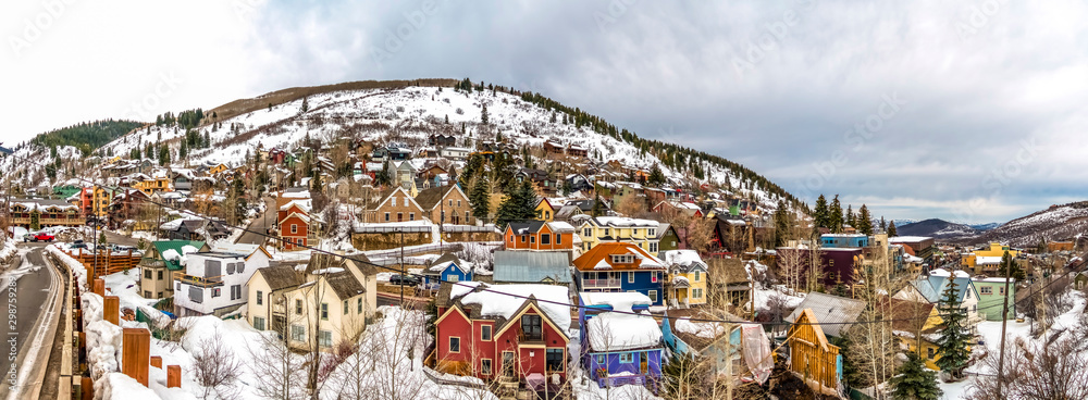 Fototapety, obrazy: Colorful mountain homes in Park City Utah with cloudy sky background in winter