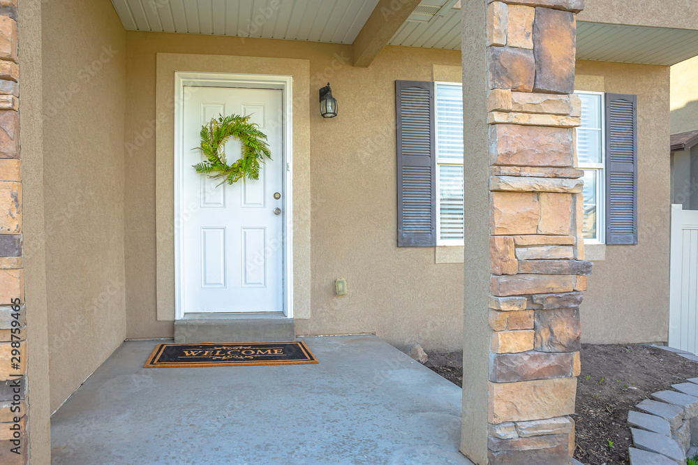 Fototapety, obrazy: Facade of a home with white front door decorated with a vibrant green wreath