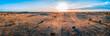 Leinwanddruck Bild - Sunrise over Australian desert - wide aerial panoramic landscape