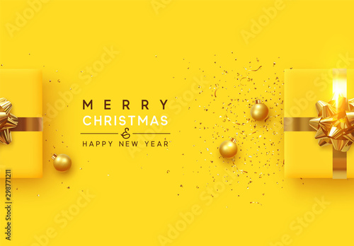 Fototapeta Christmas background. Realistic yellow gift boxes, with shiny golden confetti, Xmas balls, decorative baubles. Flat lay, top view. Festive New Year poster, greeting cards, banner. vector illustration obraz