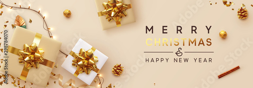 Christmas banner. Background Xmas design of sparkling lights garland, with realistic gifts box, glitter gold confetti. Horizontal New Year poster, greeting card, header, website. Design Flat top view - 298784070