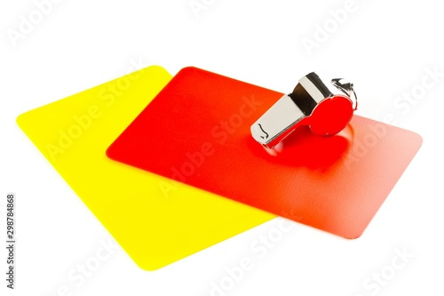 Fotografía  Soccer sports referee yellow and red cards with chrome whistle on white backgrou