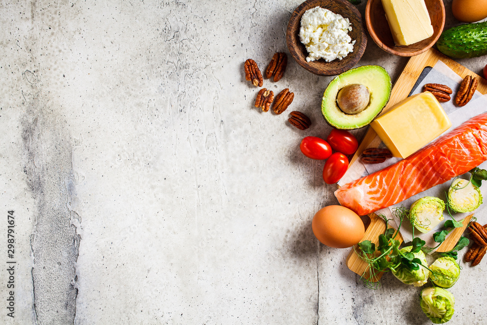 Fototapety, obrazy: Keto diet food concept. Fish, eggs, cheese, nuts, butter and vegetables - balanced food, copy space.