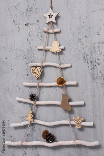 decorative christmas tree over grey concrete wall