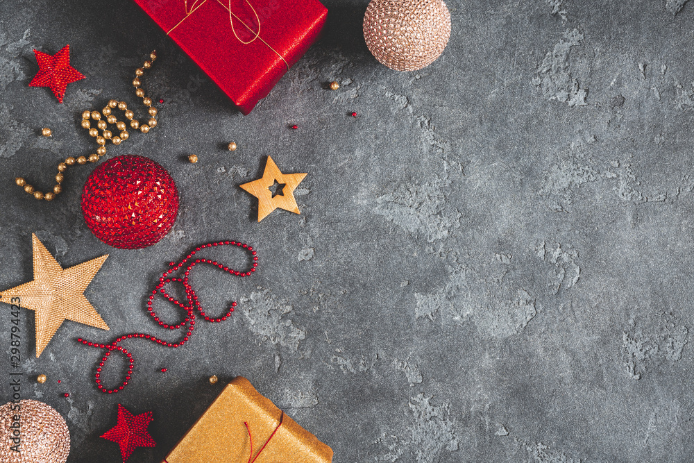 Fototapeta Christmas composition. Gifts, red and golden decorations on black background. Christmas, winter, new year concept. Flat lay, top view, copy space