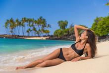 Swim Beach Asian Bikini Model Woman Sunbathing Touching Healthy Long Hair In Black Swimwear Lying Down On Sandy Beach, Hawaii Summer Vacation. Spa Wellness Concept.