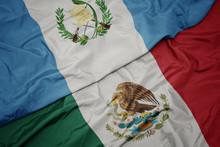 Waving Colorful Flag Of Mexico And National Flag Of Guatemala. Macro